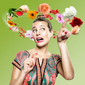 Young woman with flying flowers around her head, Composite