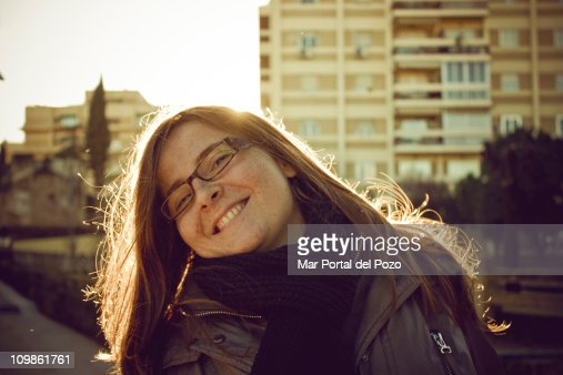 A young woman with freckles and glasses : Stock Photo