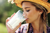 Picture of young woman with fresh organic milk