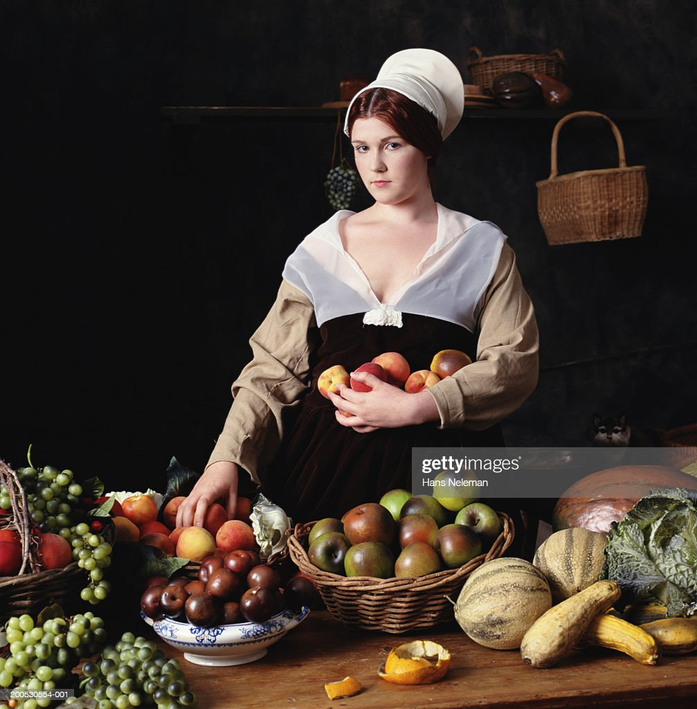 Young woman with fruits, portrait : Stock Photo