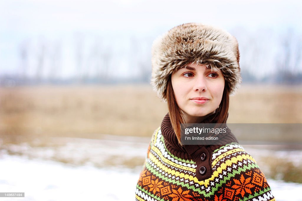 Young woman with fur hat : Stock Photo