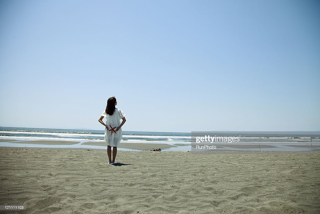 young woman with gift on the beach : Stock Photo