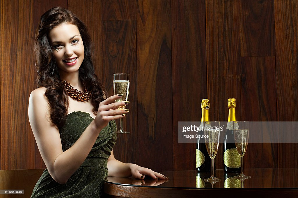 Young woman with glass of champagne, portrait : Stock Photo