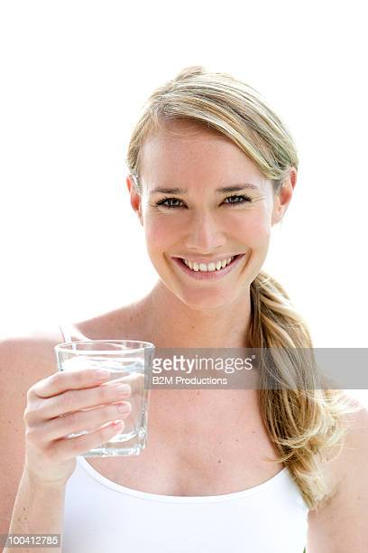 Young woman with glass of water, Portrait