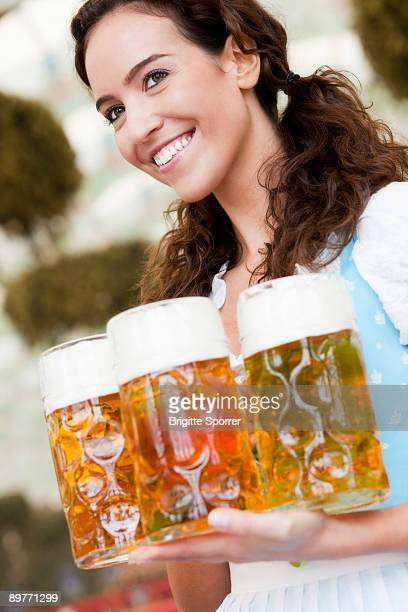 Young Woman With Glasses Of Beer