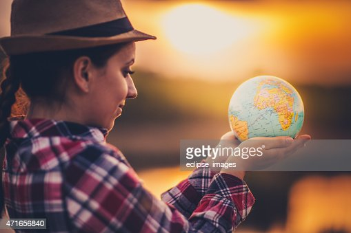 Young woman with globe