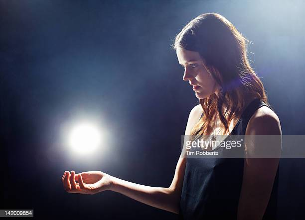 Young woman with glowing light.
