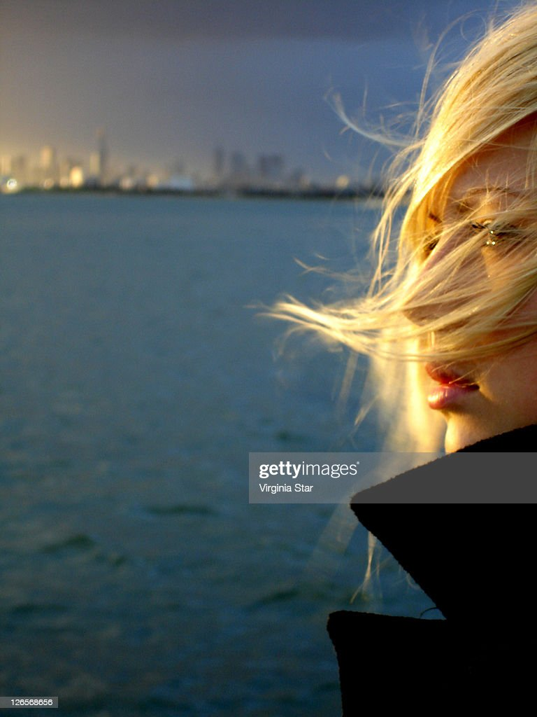 young woman with hair blowing by wing