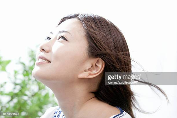 Young woman with hair blowing in the wind, Tokyo Prefecture, Honshu, Japan
