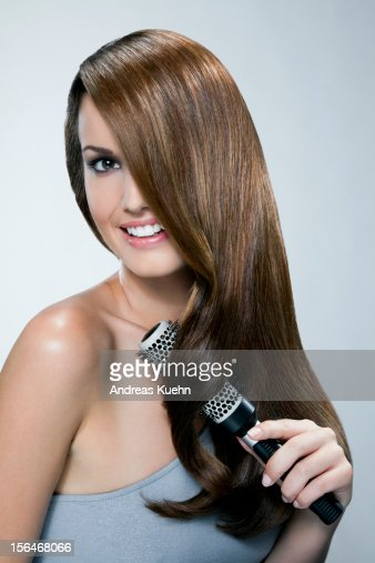 Young woman with hair brush, portrait. : Stock Photo