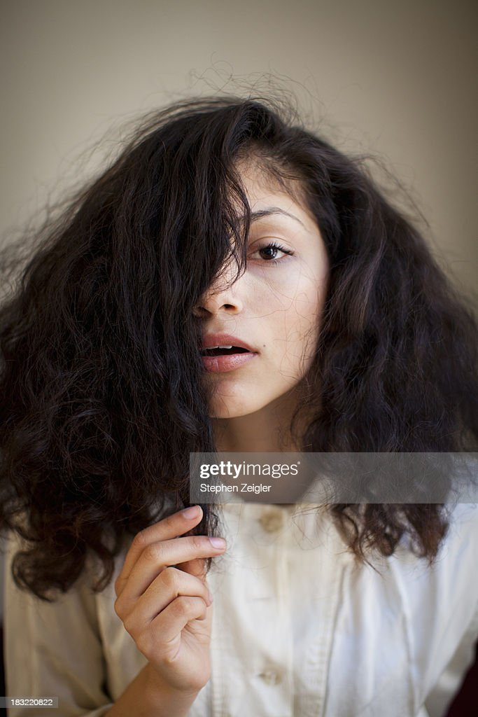 young woman with hair covering half her face : Stock Photo