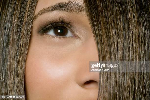 Young woman with hair covering half of face, close-up