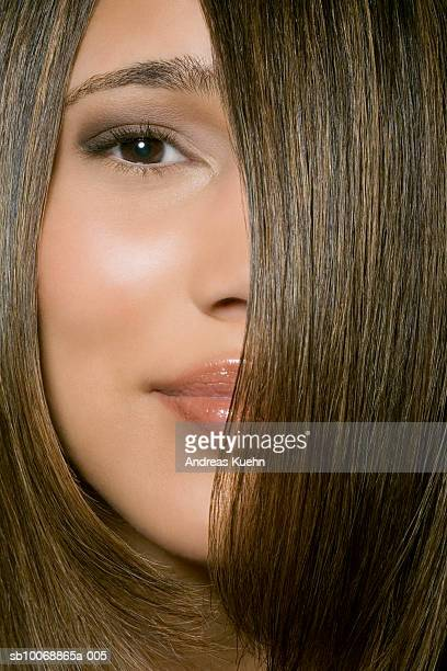 Young woman with hair covering half of face, close-up, portrait