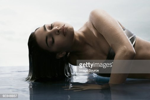 Young woman with hair in water : Stock Photo