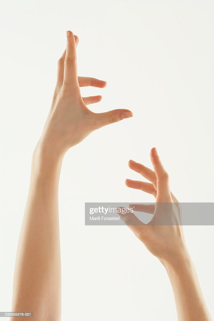 Young woman with hands in air, close-up