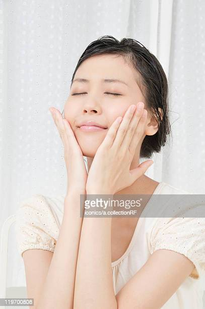 Young Woman with Hands on Her Face