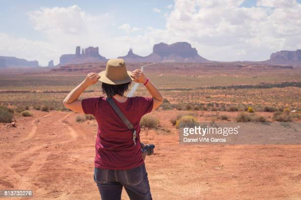 Young woman with hat at Monument Valley