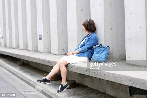 Young woman with headphones on