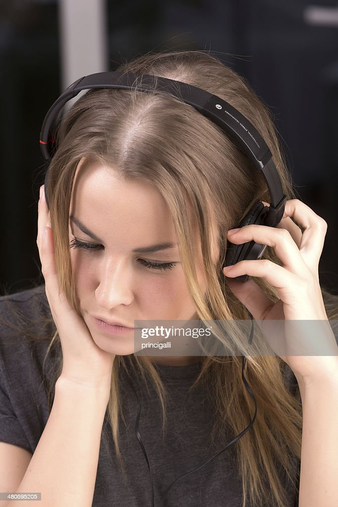 Young woman with headphones : Stock Photo