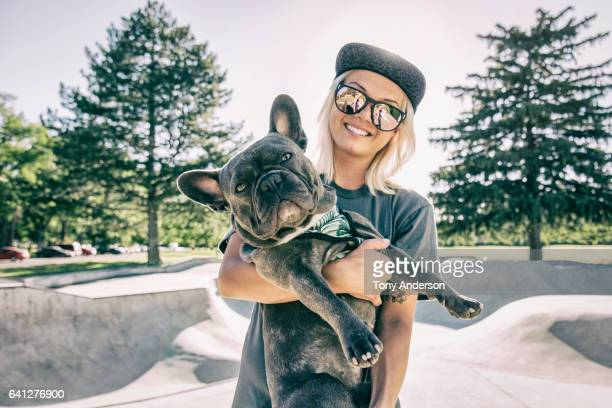 Young woman with her dog at skatepark