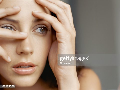 young woman with her head in her hands : Stock Photo