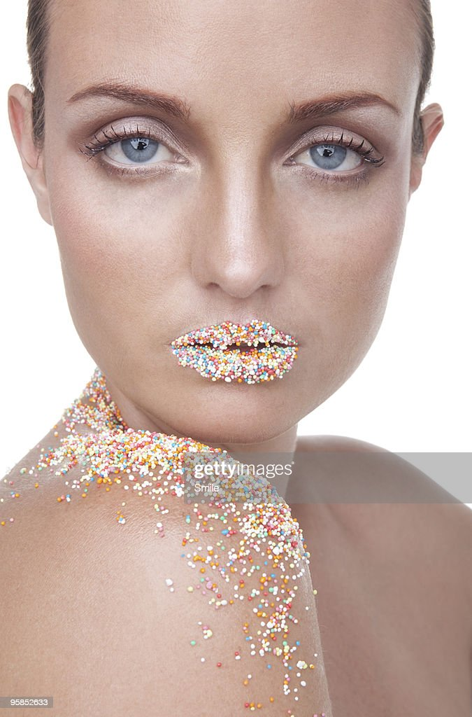 Young woman with Hundreds and Thousands on lips : Stock Photo