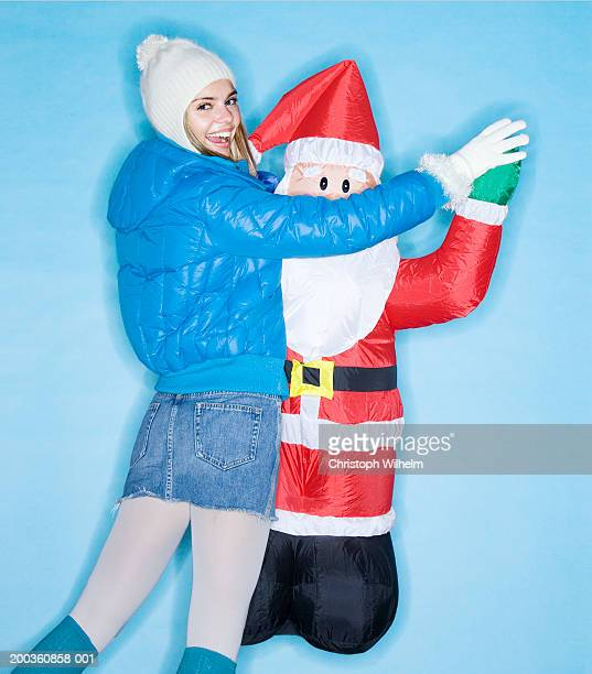 Young woman with inflatable Santa Claus
