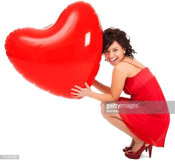 Junge Frau mit aufblasbaren Valentinstag Herz