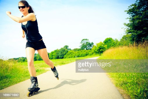 young woman with inline skates