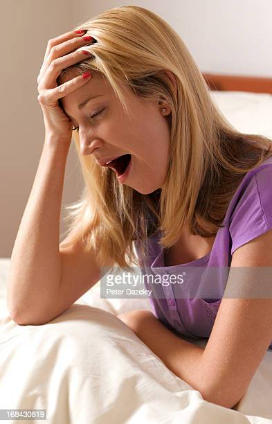 Young woman with insomnia in bedroom