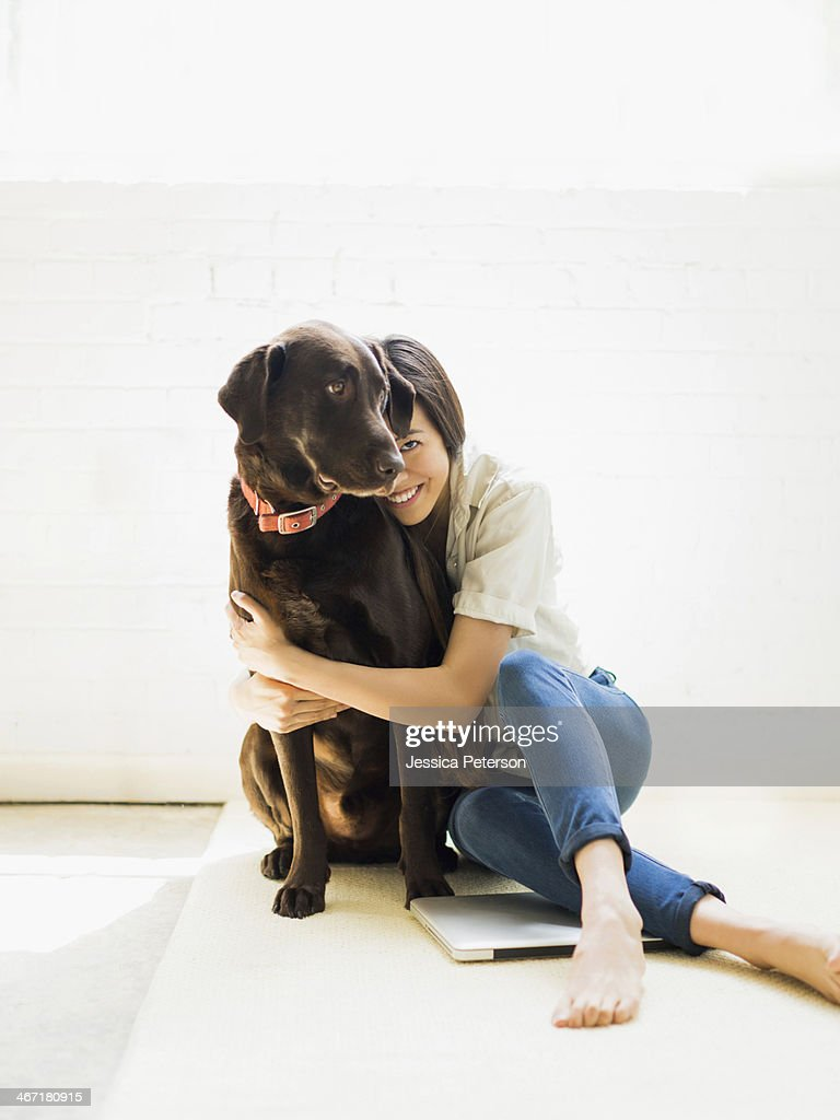 Young woman with labrador
