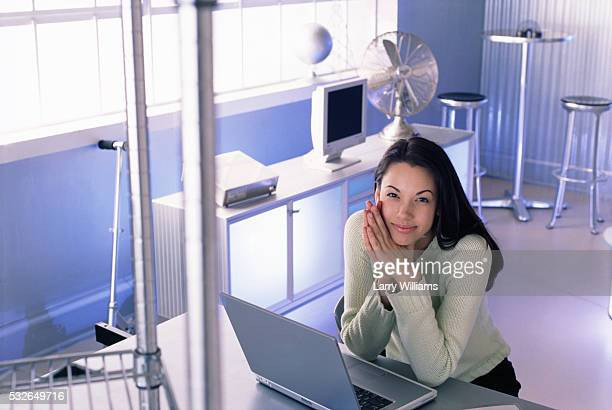 Young Woman with Laptop in Office