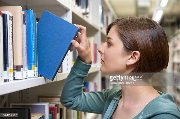 Young woman with library book