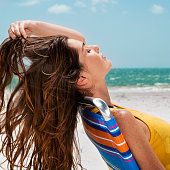 Young Woman with Long Brown Hair Relaxing at Beach