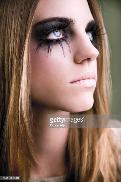 Young Woman With Long Fake Eyelashes and Dark Make-Up