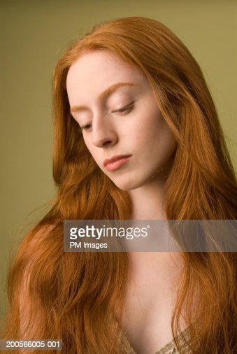 Closeup Of Young Woman With Long Ginger Hair Looking Up