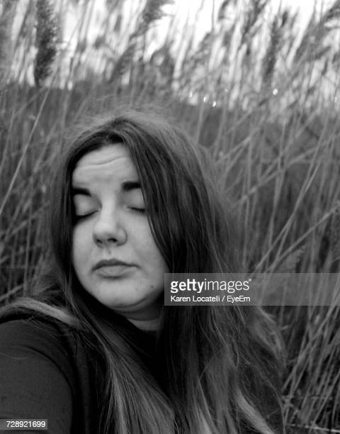 Young Woman With Long Hair Against Grass
