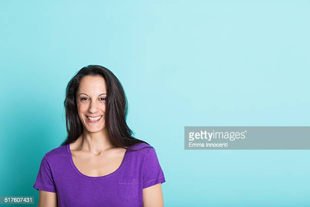 young woman with long hair and purple t-shirt