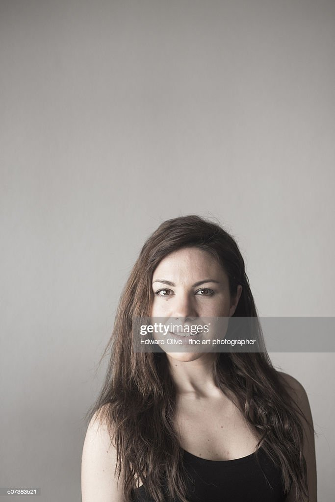 Young woman with long hair looking