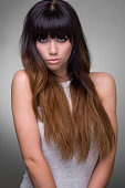 Beautiful young brunette with long straight hair - studio shot