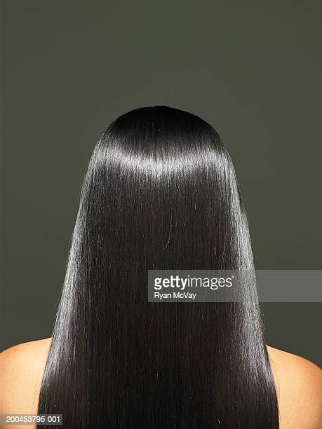 Young woman with long hair, rear view