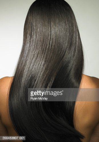 Young woman with long hair, rear view : Stock Photo