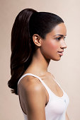 Young woman with long pony tail, profile.