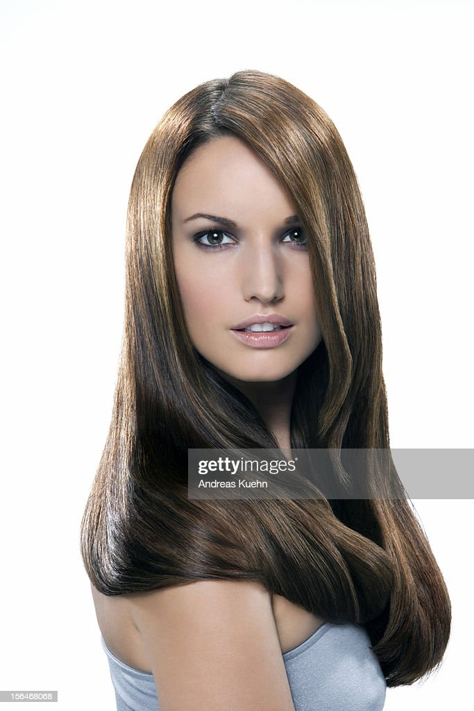 Young woman with long shiny brown hair, portrait. : Stock Photo