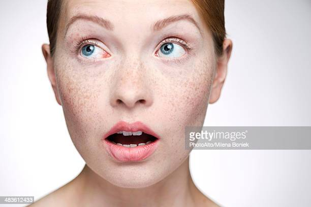 Young woman with look of surprise