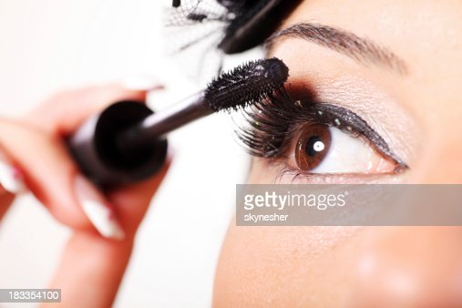 Young woman with mascara for her eyelashes.