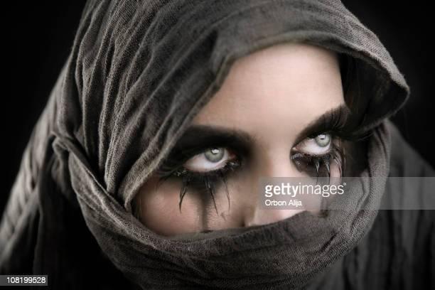 Young Woman with Mascara Running Down Cheeks Crying Wearing Tuareg