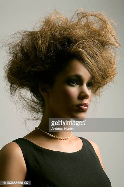 Young woman with mess hair, side view, close-up