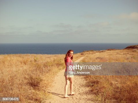 Young woman with mobile phone at scenic overlook