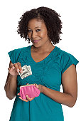 Young woman with money from her purse isolated on white